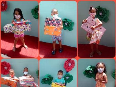 Crianças recebem presentes arrecadados durante campanha Natal do Bem